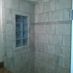 Custom tiled shower with a glass block window