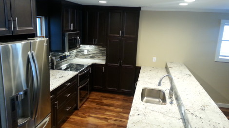 Completed Kitchen. We installed Pioneer cabinets, Latinum granite, Kitchen aid appliances and a custom  glass, slate and marble backsplash